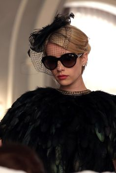 Chanel Oberlin wearing  Topshop Feather Capelet