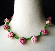 Crochet Necklace Pink Flowers Daisy Chain  This crochet necklace is made with cotton and is 2 different colors of pink flowers on a lime green chain intertwined with a grass green vine. (Inspiration from Etsy)