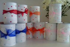 Upcycle tin cans  ~  paint  ~ paste hole punch dots  ~  & add scrap ribbon!...Use as favor tins for kids parties