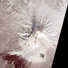 The Shiveluch volcano in Kamchatka, Russia, smolderingly visible from space. - Image credit: NASA Earth Observatory