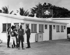 "11/26/1967-West Palm Beach, FL- Case involving members of ""Outlaws"" motorcycle club, who are accused of nailing a female member of their club to a tree for holding out $10. Photo shows a group of ""Outlaws"" outside ""Kitty's"" after it was closed"
