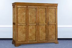 An increadible Walnut Wardrobe crafted out of mindi wood and featuring a large internal mirror. Walnut Bedroom Furniture, 4 Door Wardrobe, Hanging Rail, Walnut Veneer, Brass Handles, The Hamptons, Craftsman, Shelves, Doors