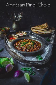 Amritsari Pindi Chole Masala is a popular North Indian vegetarian curry made w boiled chickpeas & aromatic spices & fragrant homemade chole masala North Indian Recipes, Indian Food Recipes, Asian Recipes, Ethnic Recipes, Veggie Recipes, Vegetarian Recipes, Healthy Recipes, Potluck Recipes, Vegetarian Cooking