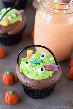 "Moist and chocolatey witch's cauldron cupcakes topped with chocolate and vanilla frosting. Secretly stuffed with a homemade orange ""scream"" filling!"