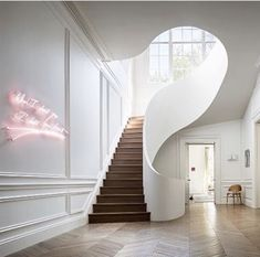 Contemporary home with curving staircase design