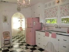 Lovely Vintage Kitchen!  I love the black/white tiles with the pastel contrast... Not very fond of pink... maybe I'd rather want it in blue/green...