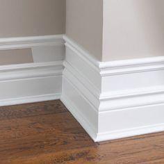 To make baseboards more dramatic add small trim to the top of existing baseboard, add a few inches and add another piece of molding. Paint the wall and trim white. This also works for crown molding! Baseboards, Wood Baseboard, Baseboard Ideas, Baseboard Styles, Faux Wainscoting, Diy Home Improvement, My New Room, Home Interior Design, Interior Trim