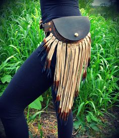 Small pouch belt with leather fringe fanny pack. $145.00, via Etsy.