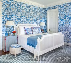 """Abiding by a """"no risk, no reward"""" mantra, Glenn went for major impact in the Blue Room by enveloping it in an intricate chinoiserie wallpaper by Brunschwig & Fils. She repeated the pattern on the drapery and chairs as a nod to historic English country homes."""