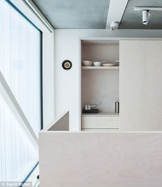 Minimalist: The walls are white and are broken up with sliding doors of whitened birch ply