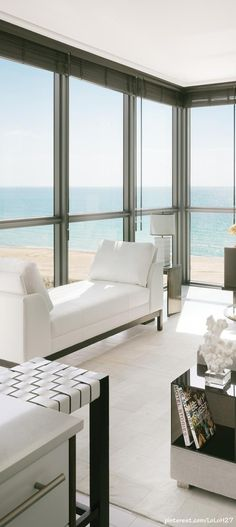 Floor to ceiling windows. It's all lovely. Living room. Beachy/coastal.