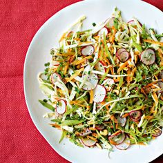 Summer Coleslaw is not your average slaw. This version  of coleslaw is extra crunchy with snow peas, radishes, and hazelnuts. | Health.com
