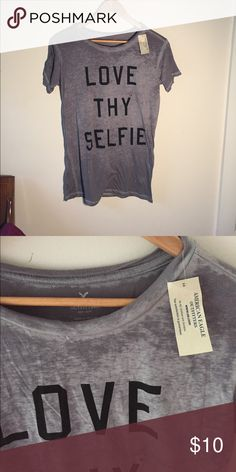 """Grey t-shirt with fade - Love Thy Selfie Very cute and loose t-shirt with faded Grey color. It says """"love thy selfie"""" on it. Never been worn, still has tags on it. American Eagle Outfitters Tops Tees - Short Sleeve"""