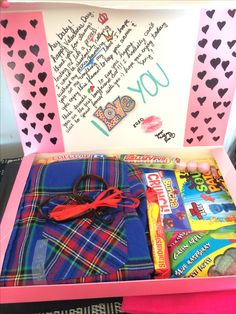 Write a cute short note :) I put hearts on the side.. Got him a warm flannel from jcp for about 9.00 and bought a bunch of his fav candy :D and walaaaa!! Adorable and inexpensive