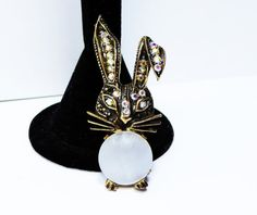 New Listings Daily - Follow Us for UpDates -  Description & Style:  Easter Bunny Brooch - Rhinestone Floppy Ears and Mother of Pearl Round Tummy - Aurora Borealis Rhinestones - #Vintage 1960s 1970s Figural offered by Th... #vintage #jewelry #teamlove #etsyretwt #ecochic #thejewelseeker