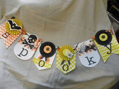 A spook-tacular banner made easy by using the build-a-banner kit and accessories kit by Stampin' Up!  Made by Erin Cook