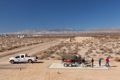 Engineers setting up the Lynx main engine in the Mojave desert for engine firing