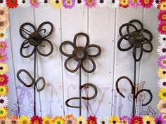 IN THE YARD:  Another great way to pretty up your fence!  Horseshoe flowers.