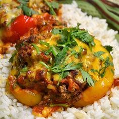 Stuffed Mexican Peppers | Mexican-inspired ground beef and rice stuffing fills red or green bell peppers for a family-pleasing meal.
