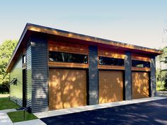 This is a single story modern garage with 3 bays and built on slab foundation.The roof has a low profile 2:12 pitch.