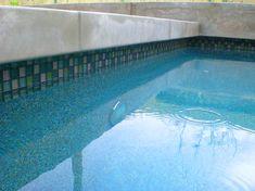 "Cast concrete coping, natural grey steel trowel finish, 4"" cantilever, 1/4"" joints. Daltile Spruce glass waterline tile."