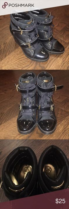 MK Black booties! Super fun sneaker type Michaal Kors black booties. Dress up with jeans. Worn only 2 or 3 times total. Great condition. (Size 9.5) KORS Michael Kors Shoes Ankle Boots & Booties