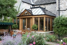 Conservatory with a natural finish - traditional - Sunroom - London - Town and Country Conservatories