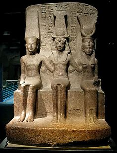 King Ramses II (1279-1213 BC) with the God Amun and Mut God, red granite temple of Amun at Thebes.