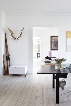 Dont like the antlers but other than that...Light, air and space are the main ingredients in the home of Danish interior designer Tina Offshore Wind