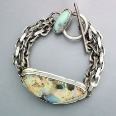 Sterling silver bracelet with a beautiful Australian boulder opal and a Peruvian opal on the clasp with a heavy silver chain. Seven inches in length. Opal Jewelry, Turquoise Jewelry, Stone Jewelry, Jewelry Art, Turquoise Bracelet, Jewelry Bracelets, Silver Jewelry, Jewelry Design, Fashion Jewelry