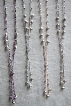 Coordinate bridesmaid dresses with these silk crochet Lariat Necklaces. Available in 14 different shades with Ethiopian Silver or Brass beads. Adds the perfect touch of bohemian elegance to your wedding party's attire.