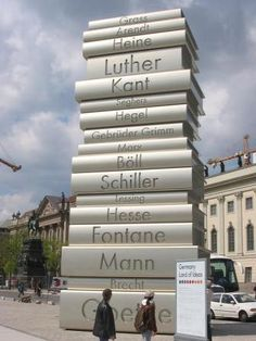 """Der Moderne Buchdruck"" (Modern Book Printing) Sculpture in Berlin, Germany.  Designed by Scholz & Friends in tribute to Gutenberg, the inventor of the printing press.  Book Authors: Günter Grass, Hannah Arendt, Heinrich Heine, Martin Luther, Immanuel Kant, Anna Seghers, Georg Wilhelm Friedrich Hegel, Brothers Grimm, Karl Marx, Heinrich Böll, Friedrich Schiller, Gotthold Ephraim Lessing, Hermann Hesse, Theodor Fontane, Thomas & Heinrich Mann, Bertolt Brecht, Johann Wolfgang von Goethe."