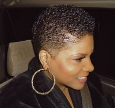 Short natural black hair. Slicked down.