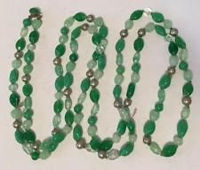 Light green color different shapes knotted beads necklace with hidden... Lot 254
