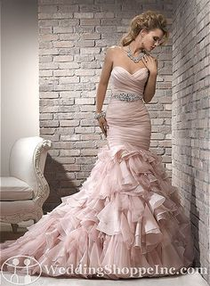 Stunning #fitandflare with a ruffled skirt. Maggie Sottero Bridal Gown Divina