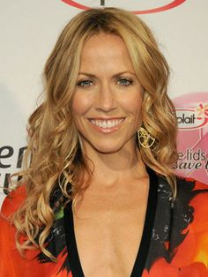 Sheryl Crow, long layers with spiral curls. would like to try this with side swept bangs.
