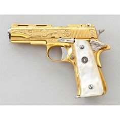 gold plated pistol - Bing Images