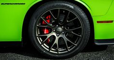 Challenger SRT® Hellcat includes 20x9.5-inch matte black lightweight forged aluminum wheels with red brake calipers. Shown in new Sublime Green.
