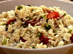 orzo salad : Food Network Giada's -- I've tweaked this over the years to use sundried tomatoes, roasted red peppers and asparagus.  Sometimes add diced chicken breast.
