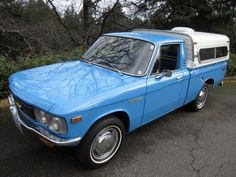 1974 Aqua Chevy Luv Truck with a camper.  I used to own this truck and LOVED it.