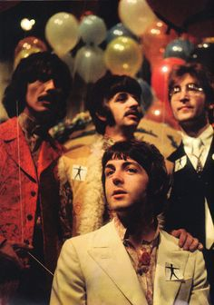 The Beatles. Check out Paul McCartney's white blazer over a pink flowered button down with perfectly placed pin button on the collar.