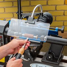Dust Right® Lathe Chip Deflector deflects chips away from the turner.