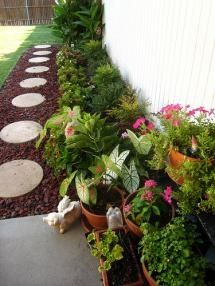side of house landscape.  Like stepping stones to allow passage. Stones