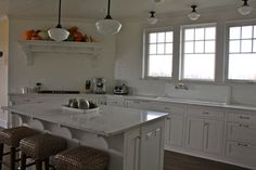 love the big windows over the huge farmhouse sink!  The island is nice, as well!