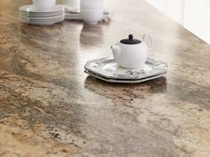 Formica 180fx 3547 Lapidus Brown reflects vibrant gold tons and rich iron veining that are timeless. Will you be looking at Lapidus Brown for your next kitchen counter top?