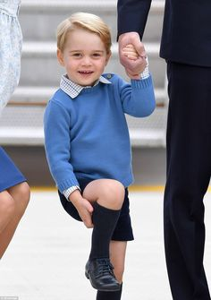 Prince George was wearing a blue jumper with blue shorts and knee-length socks but this ti...