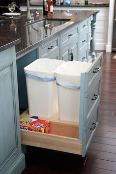 Dual Pull-Out Waste Baskets with bag storage by Mullet Cabinet in Millersburg, I have a pull out already but on a wire track that sticks....I love this idea much better!