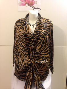 "This is a beautiful, very very gently used blouse. In excellent condition. The blouse is made of 100% polyester by the Jones New York Signature Brand. It is gold and black with animal print designs. It is a size large with the following measurements: 24"" sleeve, 28"" length, 52"" bust (lots of space). This item ships immediately. 📦 