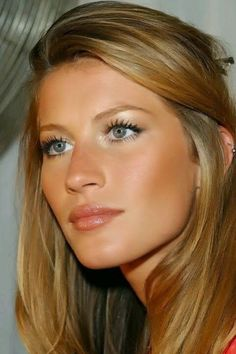 Gisele Bundchen- bronze skin, shimmery lips, blonde hair- darker underneath and lighter on top. Description from pinterest.com. I searched for this on bing.com/images