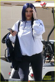 Kylie Jenner Debuts Midnight Blue Hair After Saying Her Hair Is Partially 'Destroyed': Photo #941099. Kylie Jenner looks up from her phone while leaving a photo shoot in Los Angeles on Saturday afternoon (March 12).    The 18-year-old reality star hung out with a…